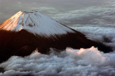 Snowcapped, holy, beautiful, perfect and serene. Mt. Fuji embodies Japan and vice versa. 