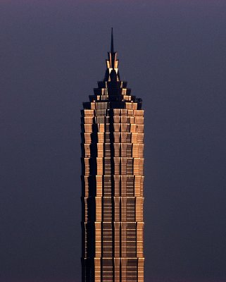 This iconic image of the Jin Mao Tower in Shanghai was taken during the late afternoon, when the sun was lighting it up with a golden glow.