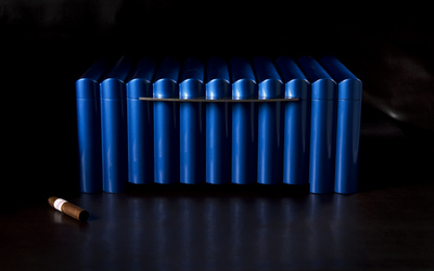 Vanishing into the dark, only the cigar provides a hint to the viewer. The powerful curves and industrial blue, form a great contrast to the light interior of this great humidor by Genco Berk.