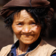 The market day was winding down and the people from the country side were packing up to go home. This lady seemed undaunted by the prospects of a long treck back home to the fields, as she smiled into the camera.